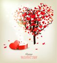 Heart shaped tree and a gift box. Valentine's day background. Ve Royalty Free Stock Photo