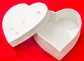 Heart shaped valentines day white box red background close up Stock Photography