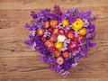 Heart shaped wreath flower on wooden background Royalty Free Stock Image