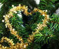 Heart shaped Xmas decoration on christmas tree Royalty Free Stock Image
