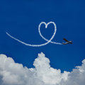 Heart in sky as symbol for love skywriter paints a the blue Royalty Free Stock Photo
