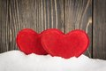 Heart in the snow on background Stock Images