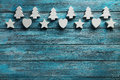 Heart stars and fir tree decorative on a blue wooden background Royalty Free Stock Photo