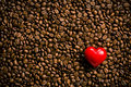 Heart of stone on coffee beans red Stock Images
