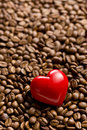 Heart of stone on coffee beans red Royalty Free Stock Photography