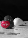 Heart stones black and white image with the words i love you in red Stock Photos
