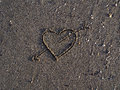 Heart symbol on sand on the beach Royalty Free Stock Photos