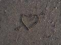Heart symbol on sand on the beach Royalty Free Stock Photos