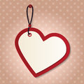 Heart tag red paper shape hanging on the pink wall Stock Images