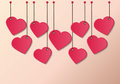 Heart tag red paper shape hanging on the pink wall Royalty Free Stock Photo