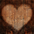 Heart on timber wall Stock Photography