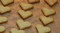 Heart to snacking a baking sheet with brown hearts Royalty Free Stock Images