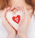 Heart toy in hands Royalty Free Stock Photo