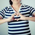 Heart using fingers closeup portrait smiling young girl makes the Royalty Free Stock Photography