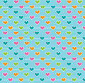 Heart wallpaper tiled background pattern of multi colored hearts on a turquoise blue background Stock Image