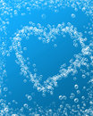Heart water bubbles and on a soft blue background Royalty Free Stock Photos