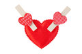 Heart on wooden clothespins a white isolated background Stock Images
