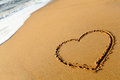 Heartin on beach sand, love concept Royalty Free Stock Photography