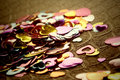 Hearts confetti on brown background Royalty Free Stock Photo