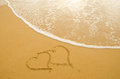 Hearts drawn on the sand beach Royalty Free Stock Photo