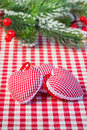 Hearts on gingham tablecloth Royalty Free Stock Photo