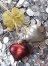 Hearts over the coins Stock Image