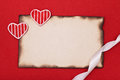 Hearts and ribbon with burnt paper Stock Photos