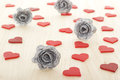 Hearts with silver colored roses for valentines day lot of Royalty Free Stock Images