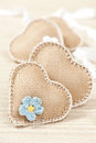 Hearts soft fabric decorated with chrochet flower on woodn surface Stock Images