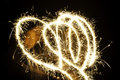 Hearts of sparkler light effect Stock Images