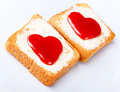 Hearts on toast in white plate Stock Photography