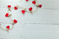 Hearts with tweezers red subjects on white wooden background Royalty Free Stock Photo