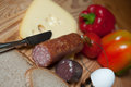 Hearty breakfast bred different sausage vegetables and beer on wooden board Royalty Free Stock Photos