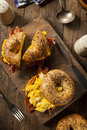 Hearty breakfast sandwich on a bagel with egg bacon and cheese Stock Photos