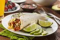 Hearty chorizo breakfast burrito with eggs cheese and hashbrowns Royalty Free Stock Image