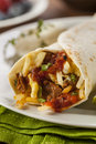 Hearty chorizo breakfast burrito with eggs cheese and hashbrowns Stock Image