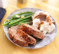Hearty meatloaf dinner with sides close up photo of a Stock Image