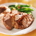 Hearty meatloaf dinner with sides close up photo of a Royalty Free Stock Photos