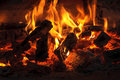Heat and flame of fire in the fireplace Royalty Free Stock Photo