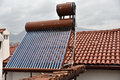 Heat pipe solar collector at rooftop of a house Royalty Free Stock Photography
