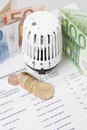 Heating costs cost concept with money and thermostat Stock Image