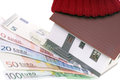 Heating costs small house with hat and euro banknotes Royalty Free Stock Images