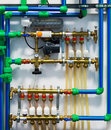 Heating system pipes pumps valves and thermostats of Stock Images