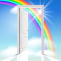 Heavenly doors white through which the sun is visible celestial clouds and rainbow Royalty Free Stock Images