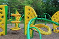 Heavily constructed playground equipment at outdoor park where children love to come and have fun together Royalty Free Stock Images
