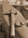 Heavy anvil and sturdy hammer in the blacksmith s shop Stock Photography