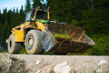 Heavy bulldozer on country road Stock Photo