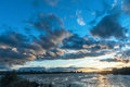 Heavy clouds on the evening city river Royalty Free Stock Photo