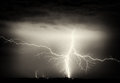 Heavy clouds, thunder, lightnings and rain during storm over city Royalty Free Stock Photo