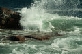 Heavy crashing surf on rocks waves coastal maine create some serious dangerous conditions Stock Photo